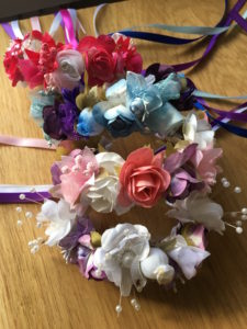 Different color's of Flower wreaths made by Ribbons On Top.